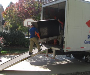 Movers Loading a Sofa on Truck