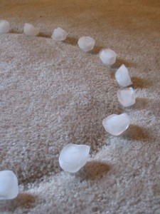 Ice cubes on carpet dents