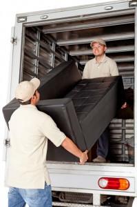 Professional Movers Lifting a Sofa